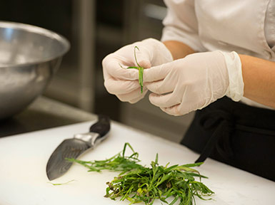 student in Owens culinary lab