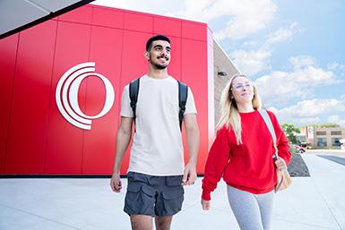 Owens students walking outside